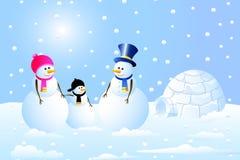Famille d'igloo et de bonhomme de neige Photo stock