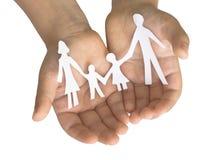 Famille dans les mains de l'enfant Photographie stock