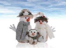 Famille de bonhomme de neige Photographie stock libre de droits