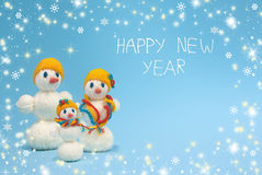 Famille de bonhommes de neige de Noël An neuf heureux Photos stock