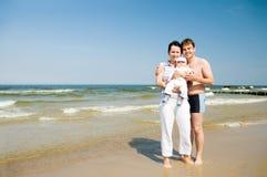 famille de plage Photos stock