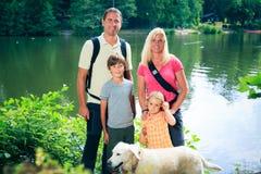 Famille de quatre augmentant Photographie stock