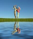 Famille de quatre et lac Photo stock