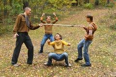 Famille de quatre se reposant Photo libre de droits