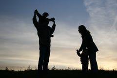 Famille de silhouette de quatre Photos libres de droits