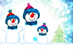 Famille de trois bonhommes de neige Photographie stock