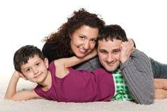 Famille de trois heureuse ensemble Images stock