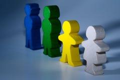 Famille des jouets en bois sur le fond d'isolement gris Images libres de droits