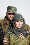 Famille des militaires sur un fond clair Photos stock