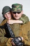 Famille des militaires sur un fond clair Photos libres de droits
