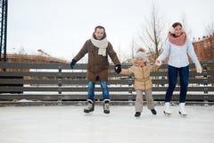 Famille des patineurs Photo stock