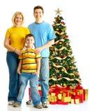 Famille et un arbre de Noël Images stock
