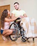 Famille heureuse avec le conjoint handicapé Image stock