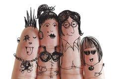 Famille heureuse avec le smiley peint sur les doigts humains Image libre de droits