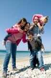 Famille heureuse ayant l'amusement Image libre de droits