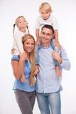 Famille heureuse d'isolement sur le fond blanc Photos stock