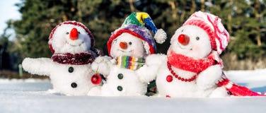 Famille heureuse de bonhomme de neige Photo stock