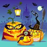 Famille heureuse de Halloween des potirons Photo stock