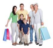 Famille heureuse de rétablissements avec des sacs à provisions Photos stock