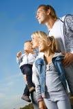 Famille heureuse extérieure Photographie stock