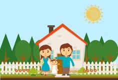 Famille heureux avec la maison Image stock