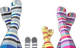 Famille heureux dans les chaussettes stripy Images libres de droits