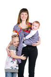 Famille, mère et chéri dans une élingue Images libres de droits