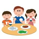 Famille, mangeant Images libres de droits