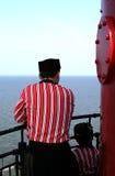 Famille, mer et phare Images libres de droits