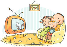 Famille regardant la TV ensemble Photos stock