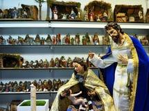 Famille sainte, petits chiffres de Belen, marché de Noël Photographie stock