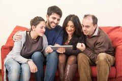 Famille sur le sofa Photo libre de droits