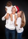 Famille sur un fond noir Photo libre de droits