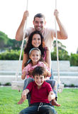 Famille sur une oscillation Photos stock