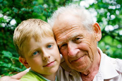 Family. Young boy - grandchild, and his grandfather - old man Royalty Free Stock Images