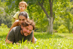 Family. Photo of a family enjoying a summer day on a green meadow Stock Image