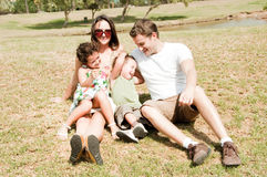 Family. Young couple and enjoying with two young children royalty free stock image