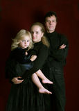 Family. Man and women with smal girl Stock Image