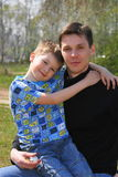Family. Little boy with fother look at camera Stock Photography