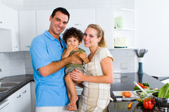 Family. Happy young family cooking food in kitchen Stock Photography