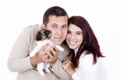 Family. A happy family..man woman and a little puppy Royalty Free Stock Photography