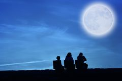 Family. Looking to the moon Stock Images