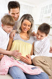Family. Smiling beautiful pregnant mother and family at home royalty free stock images
