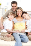 Family. Smiling beautiful pregnant mother and family at home stock images