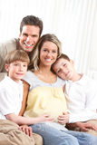 Family. Smiling beautiful pregnant mother and family at home stock photo