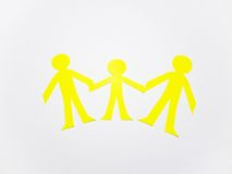 Family. From yellow paper on white background Royalty Free Stock Photography