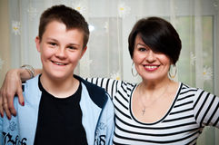 Family. Mature woman with a teenage boy in a family portrait setting Royalty Free Stock Images