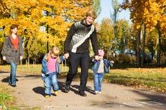Family. Running in autumn park Stock Photos