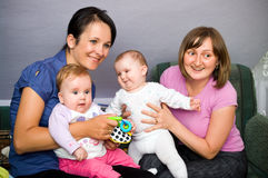 Family. Portrait of two mothers and their babies Royalty Free Stock Image