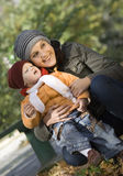 Family. Mother and the daughter play autumn park Royalty Free Stock Photo